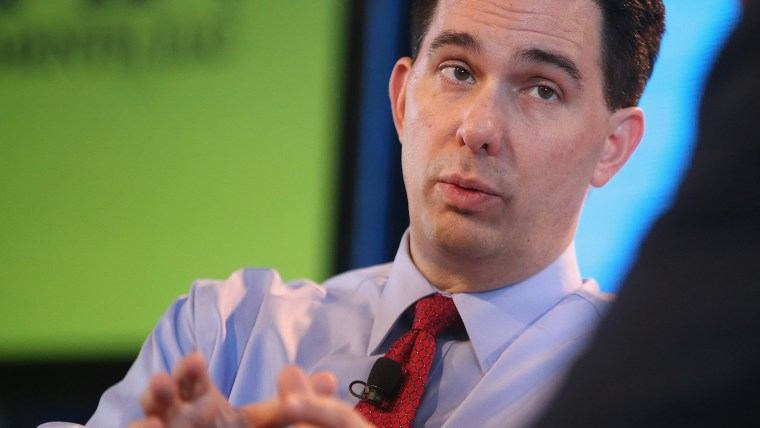Wisconsin Governor Scott Walker fields questions from Bruce Rastetter at the Iowa Ag Summit on March 7, 2015 in Des Moines, Iowa. (Photo by Scott Olson/Getty)