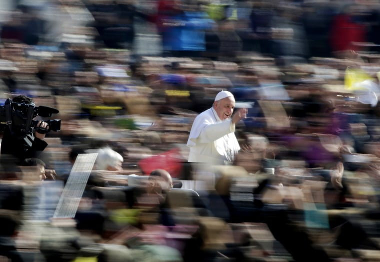 Pope Francis waves as he arrives during the general audience in St. Peter's Square at the Vatican March 4, 2015. (Photo by Max Rossi/Reuters)