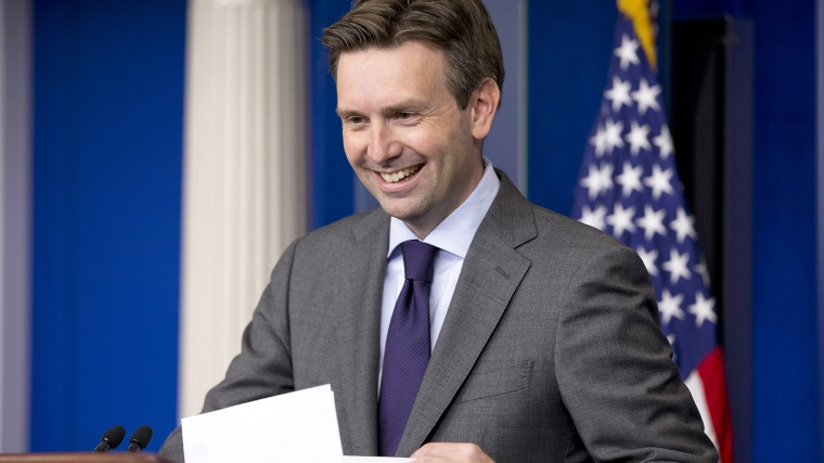 White House press secretary Josh Earnest laughs as he enters the briefing room to speak to the media during his daily news briefing at the White House in Washington, D.C., July 11, 2014. (Photo by Jacquelyn Martin/AP)