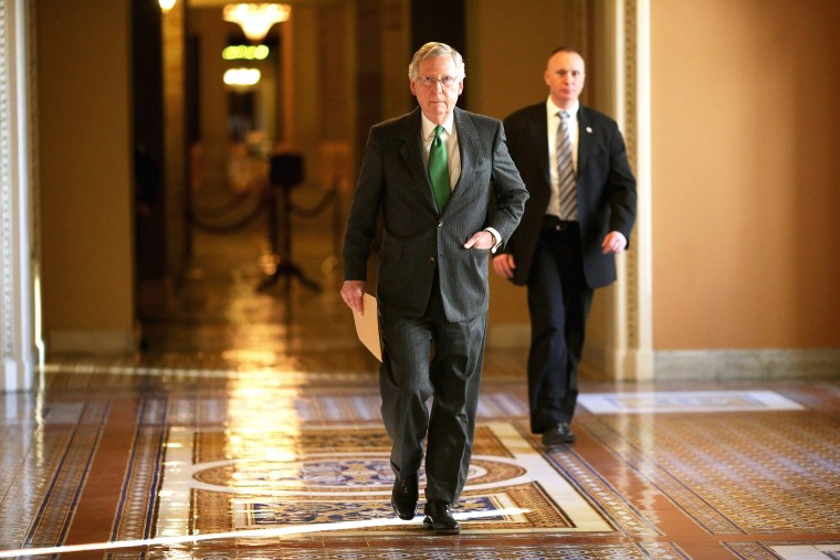 Senate Majority Leader Mitch McConnell (R-KY) walks from his office in the U.S. Capitol to the Senate chamber on Feb. 23, 2015 in Washington, D.C. (Photo by Chip Somodevilla/Getty)