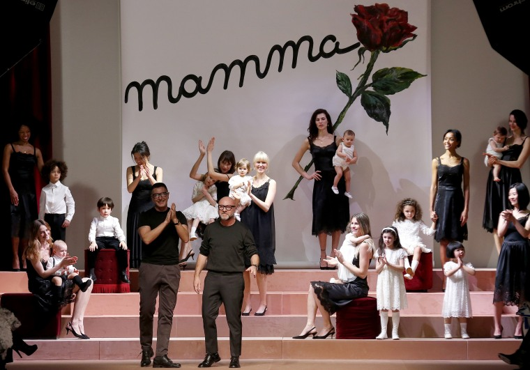 Italian designers Domenico Dolce and Stefano Gabbana acknowledge the audience at the end of their Autumn/Winter 2015/16 collection during Milan Fashion Week March 1, 2015. (Photo by Alessandro Bianchi/Reuters)