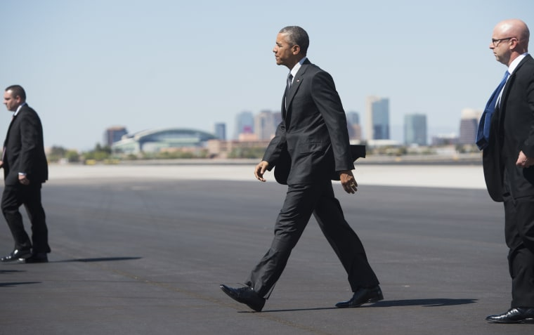 US President Barack Obama walks across the tarmac upon arrival on Air Force One at Phoenix Sky Harbor International Airport in Phoenix, Ariz., March 13, 2015. (Photo by Saul Loeb/AFP/Getty)