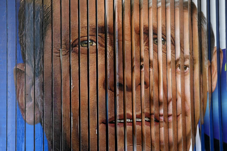 A rotating billboard that shows the faces of the two candidates for Israel's prime minister, incumbent Benjamin Netanyahu (R) and opposition leader Yitzhak Herzog, in Tel Aviv, Israel on March 12, 2015.