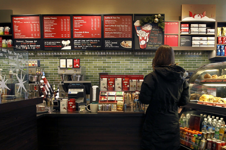 A Starbucks customer orders at a Chicago area store, Dec. 5, 2012. (Photo by Charles Rex Arbogast/AP)