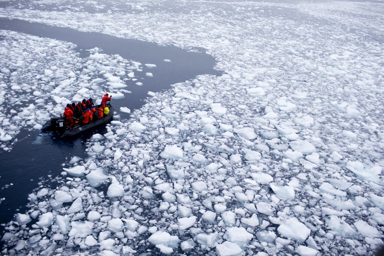 In this Jan. 22, 2015 photo, a zodiac carrying a team of international scientists heads to Chile's station Bernardo O'Higgins, Antarctica. (Photo by Natacha Pisarenko/AP)