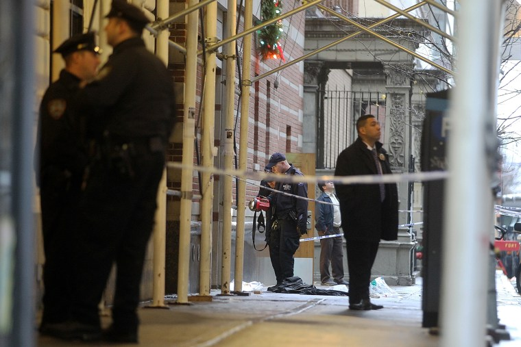 Police investigate the scene of a fatal shooting at 202 West 58th Street in Manhattan on Dec. 10, 2012 in New York City.