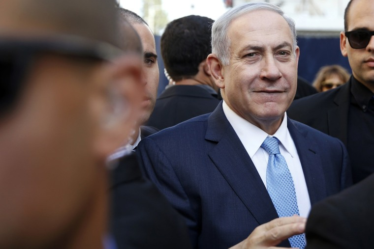 Israel's Prime Minister Benjamin Netanyahu (C) campaigns in the southern city of Ashkelon March 17, 2015.