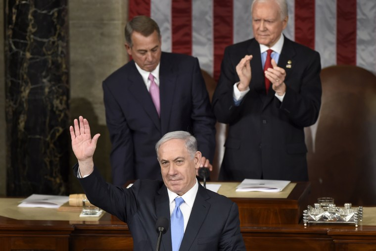 Israeli Prime Minister Benjamin Netanyahu waves as he speaks before a joint meeting of Congress on Capitol Hill in Washington on March 3, 2015. (Photo by Susan Walsh/AP)