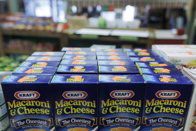 Packages of Kraft Macaroni & Cheese fill the shelves of a store on May 4, 2009, in Chicago Ridge, Ill. (Photo by M. Spencer Green/AP)