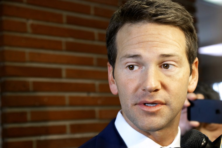 In this Feb. 6, 2015 file photo, Rep. Aaron Schock, R-Ill. speaks to reporters in Peoria Ill. (Photo by Seth Perlman/AP)