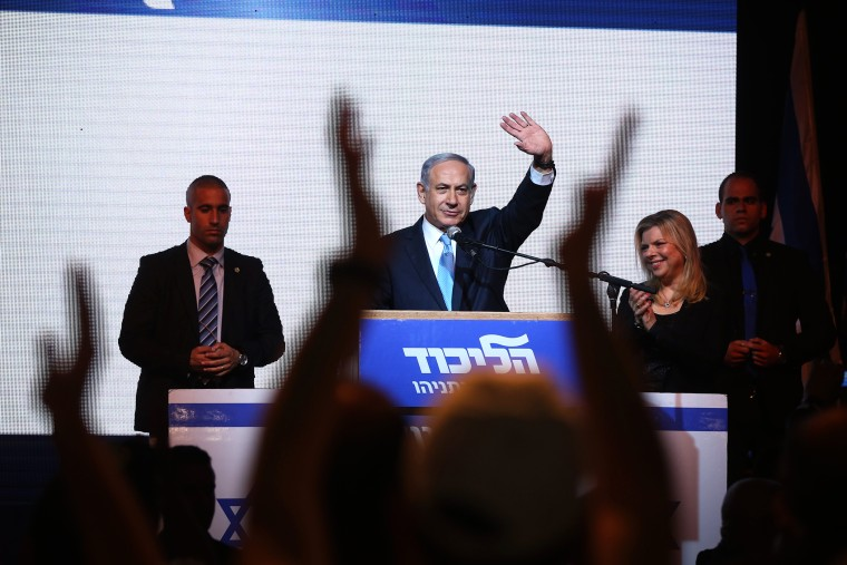 Israeli Prime Minister Benjamin Netanyahu (C) delivers a speech next to his wife Sara as he reacts to exit poll figures in Israel's parliamentary elections late on March 17, 2015 in Tel Aviv, Israel. (Photo by Menahem Kahana/AFP/Getty)