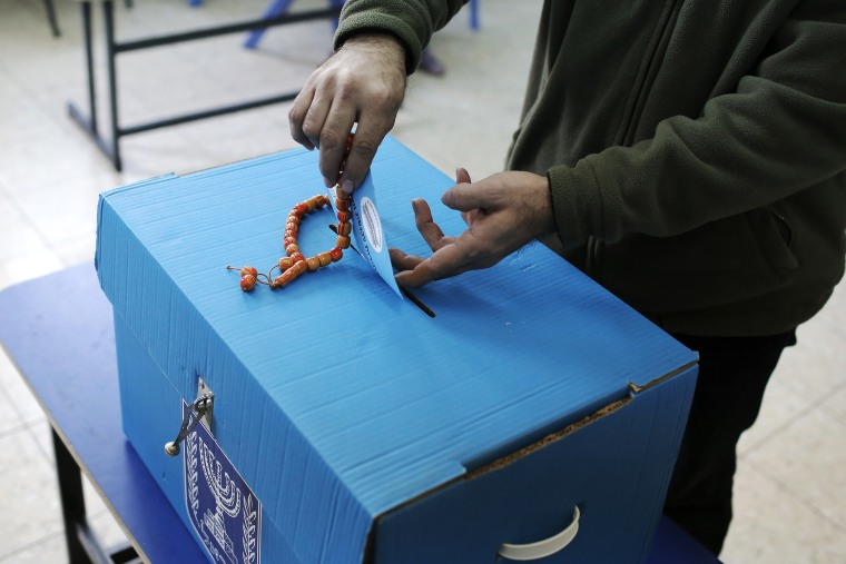 An Arab Israeli man casts his ballot at a polling station in the northern Israeli town of Umm al-Fahm on March 17, 2015. (Photo by Ahmad Gharabli/AFP/Getty)