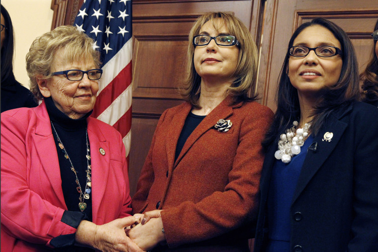 Former U.S. Rep. Gabrielle Giffords, center, of Arizona, poses for photographs with New Jersey Assemblywoman Gabriela Mosquera, right, D-Turnersville, N.J., and state Sen. Loretta Weinberg, left, D-Teaneck, N.J., after a meeting on March 18, 2015.