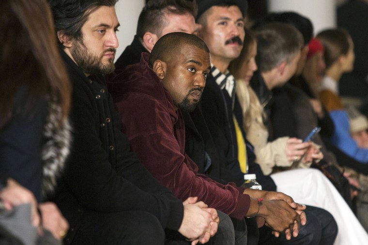 Singer Kanye West sits in the front row at the Jeremy Scott Fall/Winter 2015 collection show at New York Fashion Week on Feb. 18, 2015. (Photo by Andrew Kelly/Reuters)