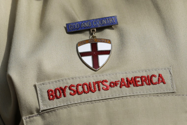 This photo taken Monday, Feb. 4, 2013, shows a close up detail of a Boy Scout uniform in Irving, Texas. (Photo by Tony Gutierrez/AP)