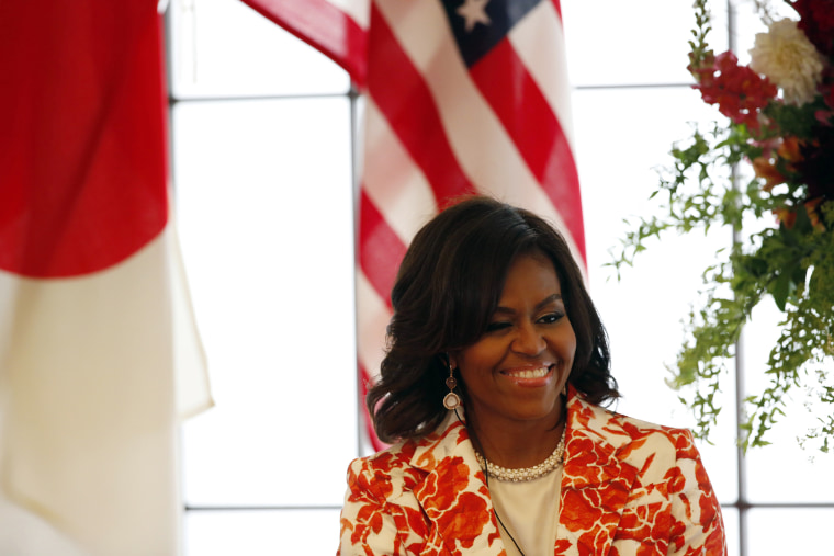 First Lady Michelle Obama smiles as she attends an event discussing education for girls at the Iikura Guest House in Tokyo March 19, 2015. (Photo by Issei Kato/Reuters)