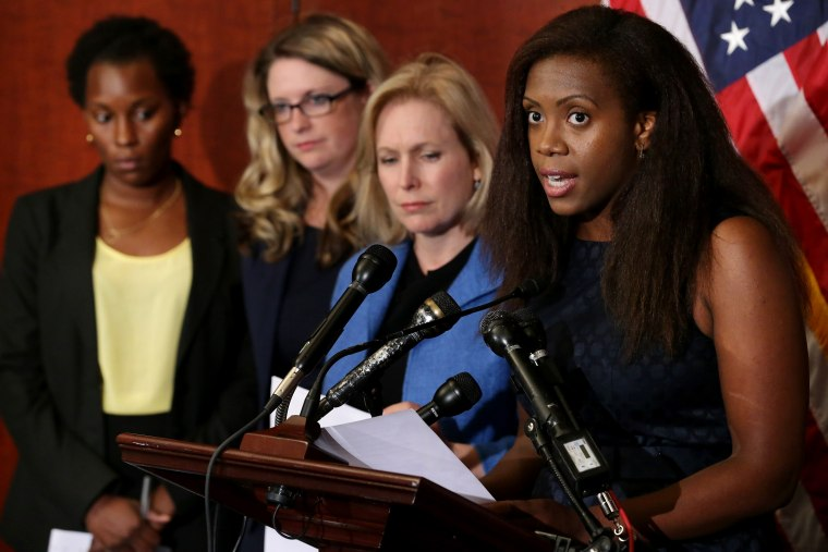 Wagatwe Wanjuki speaks about being a campus sexual assault survivor with Sen. Kristen Gillibrand and fellow survivors Annie Clark and Tre'Shonda Sheffey during a news conference at the US Capitol, July 30, 2014. (Photo by Chip Somodevilla/Getty)
