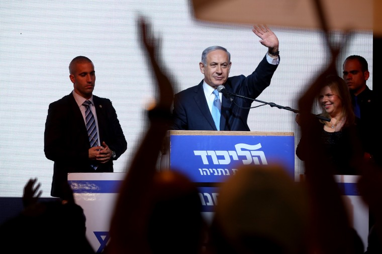 Israeli Prime Minister Benjamin Netanyahu delivers a speech next to his wife Sara as he reacts to exit poll figures in Israel's parliamentary elections late on March 17, 2015 in the city of Tel Aviv. (Photo by Menahem Kahana/AFP/Getty)