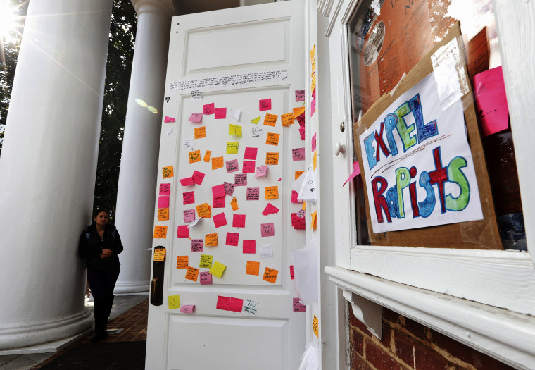 Postings on the door of Peabody Hall related to the Phi Kappa Psi gang rape allegations at the University of Virginia in Charlottesville, Va., Nov. 24, 2014. (Photo by Steve Helber/AP)