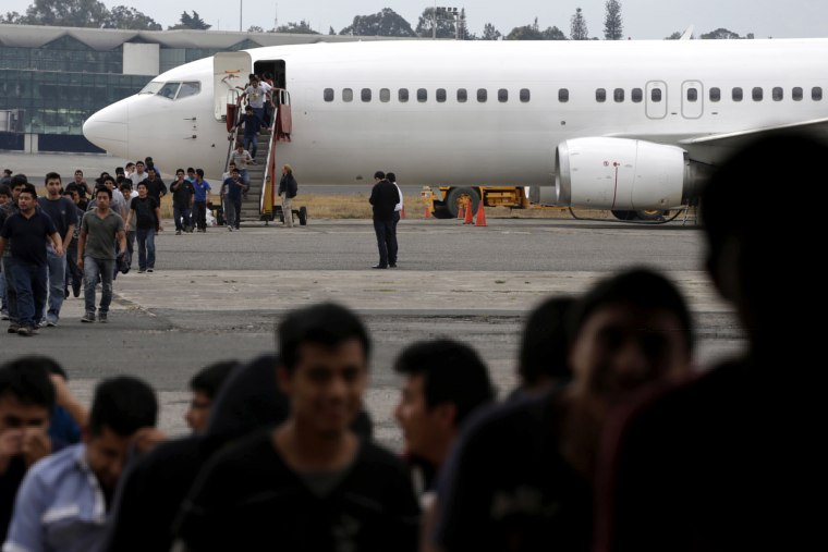 Illegal migrants from Guatemala, deported from the US, arrive at an air force base, Guatemala City, March 19, 2015. The flight carrying some 150 illegal migrants was part of a five day operation that deported thousands. (Photo by Jorge Dan Lopez/Reuters)
