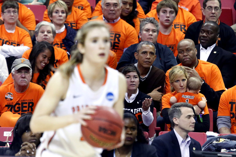 US President Barack Obama attends the game between Princeton and Green Bay for the 2015 Women's NCAA Basketball Tournament in College Park, Md., March 21, 2015. Obama's niece Leslie Robinson plays for Princeton. (Photo by Yuri Gripas/Reuters)