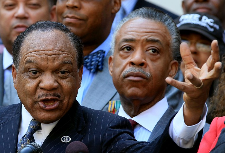 The Rev. Walter Fauntroy (L) gestures as he speaks, while the Rev. Al Sharpton (R), listens during a news conference in front of the John A. Wilson Building on Aug. 27, 2010 in Washington, DC. (Photo by Mark Wilson/Getty)