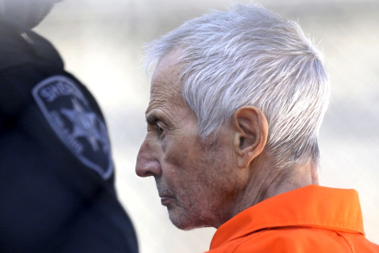 Robert Durst is escorted into Orleans Parish Prison after his arraignment in Orleans Parish Criminal District Court in New Orleans, on March 17, 2015.