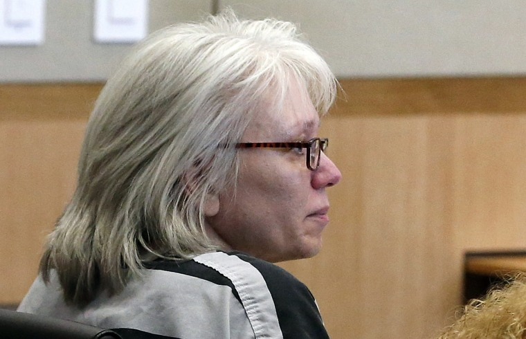 Debra Jean Milke listens to a judge during a hearing at Maricopa County Superior Court in Phoenix in 2013.