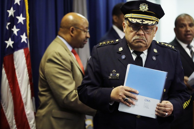 Philadelphia Police Commissioner Charles Ramsey holds a newly released report during a news conference on March 23, 2015, in Philadelphia. (Photo by Matt Rourke/AP)