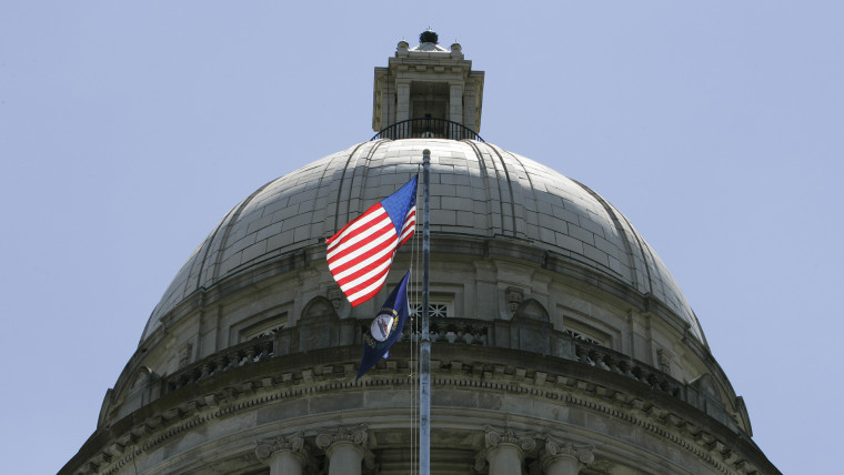 The American flag flies in front of the Capitol Rotunda in Frankfort, Ky.