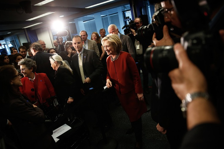 Former U.S. Secretary of State Hillary Clinton greets members of the audience after speaking at the Center for American Progress March 23, 2015 in Washington, DC. (Photo by Win McNamee/Getty)