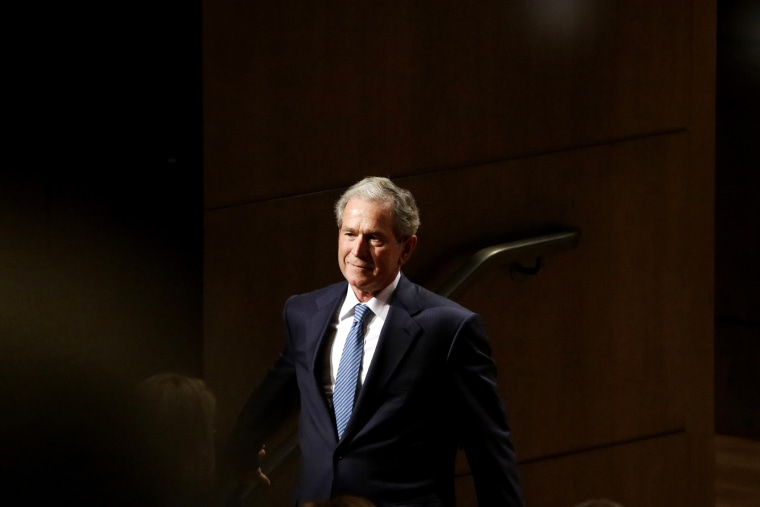 Former President George W. Bush smiles as he walks off stage during an event on Feb. 19, 2014, in Dallas, Texas. (Photo by LM Otero/AP)