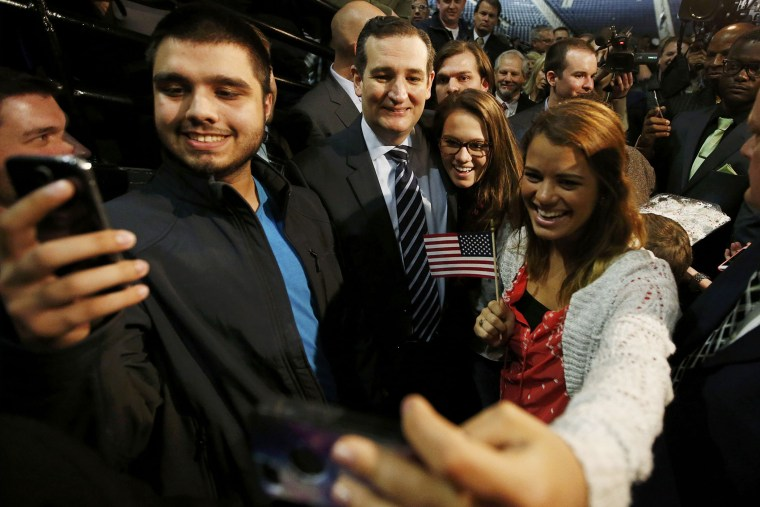 """Sen. Ted Cruz (R-TX) poses for pictures with students shooting \""""selfies\"""" after confirming his candidacy for the 2016 U.S. presidential election race during a speech at Liberty College in Lynchburg, Va. on March 23, 2015. (Photo by Chris Keane/Reuters)"""