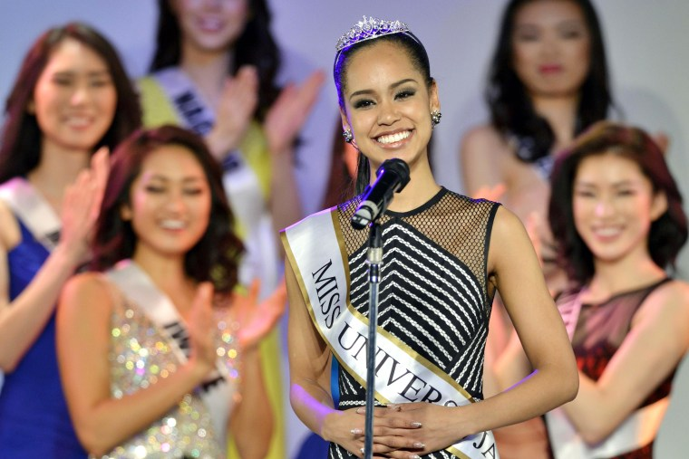 Ariana Miyamoto (C) from Miyazaki Prefecture, southwestern Japan, makes a speech in Tokyo on March 12, 2015 after being chosen to represent the country at this year's Miss Universe contest. (Photo by Kyodo/AP)