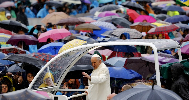 Pope Francis waves as he arrives to lead the weekly audience in Saint Peter's square at the Vatican March 25, 2015. (Photo by Stefano Rellandini/Reuters)