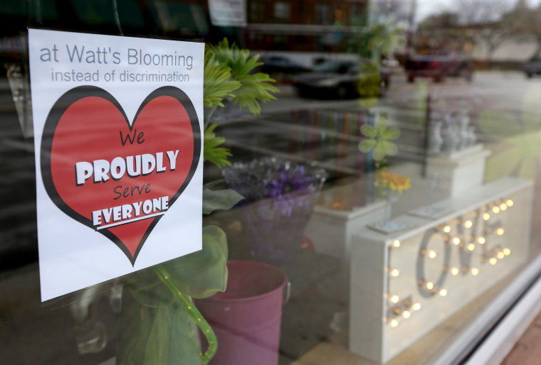 A window sign on a downtown Indianapolis florist, March 25, 2015, shows it's objection to the Religious Freedom bill passed by the Indiana legislature. (Photo by Michael Conroy/AP)