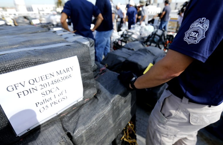 Drug Enforcement Agency (DEA) agents take inventory of seized cocaine packages, on the deck of the US Coast Guard Cutter Boutwell at Naval Base San Diego in San Diego, Oct. 6, 2014. (Photo by Mike Blake/Reuters)