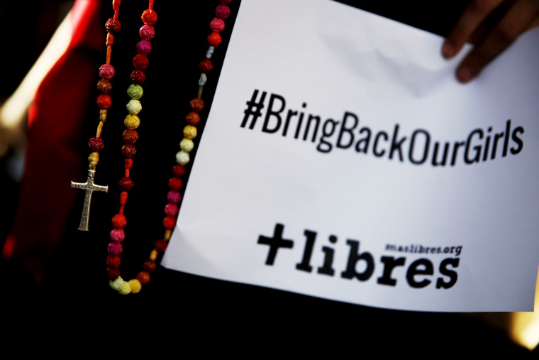 A poster with the Twitter campaign hashtag #BringBackOurGirls is seen during a prayer vigil showing support for Nigerian schoolgirls abducted by militant group Boko Haram, outside the Nigerian Embassy in Madrid May 22, 2014. (Photo by Susana Vera/Reuters)