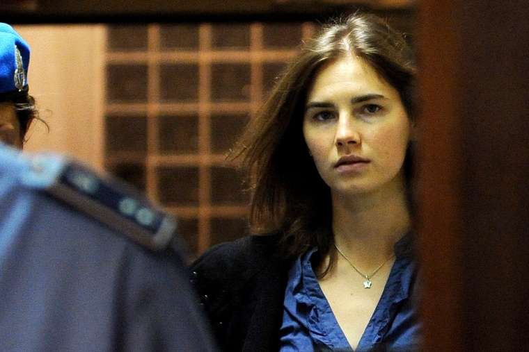 Amanda Knox (R), US national accused of the 2007 murder of her housemate Meredith Kercher arrives at the court during the resumption of her appeal trial in Perugia on Sept. 30, 2011. (Photo by Tiziana Fabi/AFP/Getty)