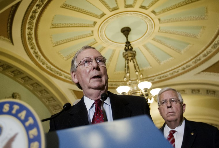 Senate Majority Leader Mitch McConnell of Ky., accompanied by Sen. Mike Enzi, R-Wyo., speaks to reporters on Capitol Hill in Washington, March 24, 2015. (Photo by Pablo Martinez Monsivais/AP)