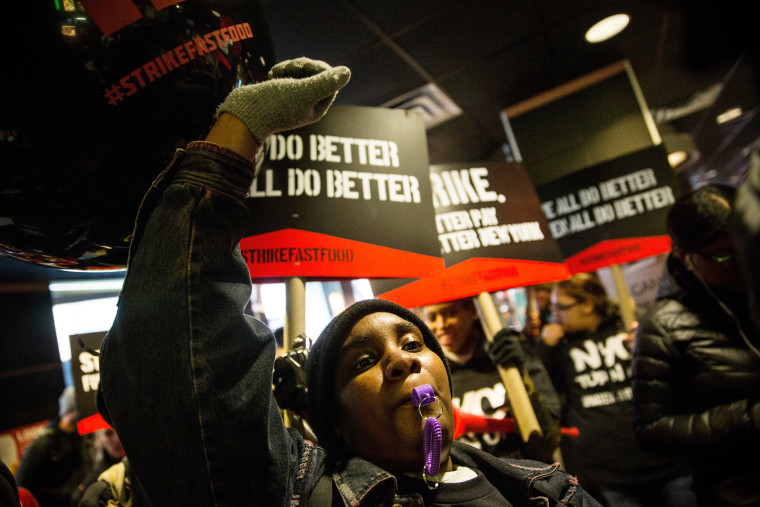 Protesters march through a McDonalds demanding a raise on the minimum wage to $15 per hour on Dec. 4, 2014 in New York.