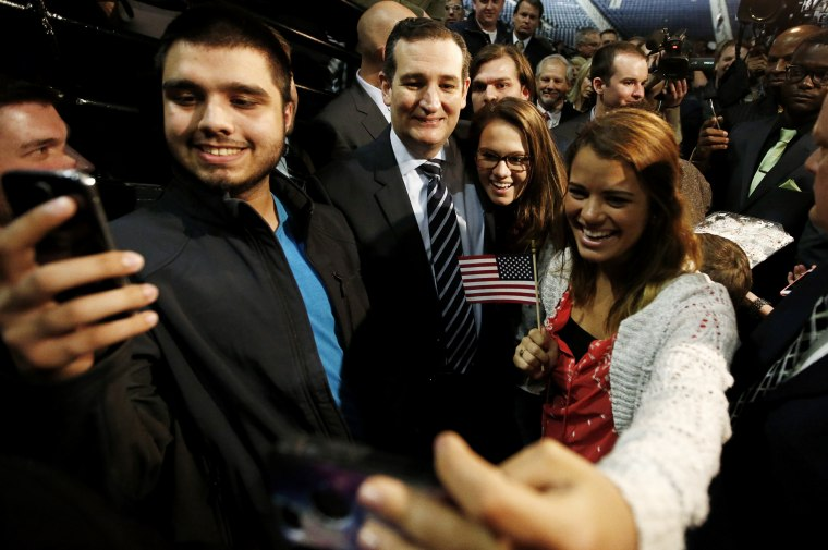 """US Senator Ted Cruz (R-TX) poses for pictures with students shooting """"selfies"""" after confirming his candidacy for the 2016 presidential election race during a speech at Liberty College in Lynchburg, Va., March 23, 2015. (Photo by Chris Keane/Reuters)"""
