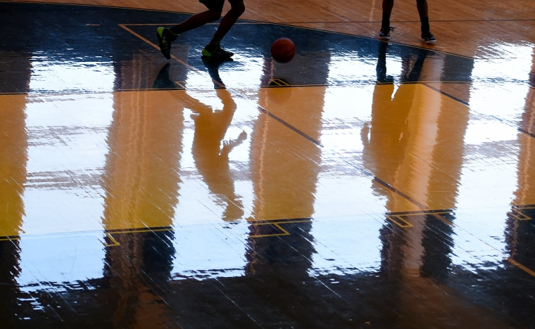 Archbishop Carroll High School basketball players work out during practice on Feb. 12, 2015 in Washington, DC. (Photo by Jonathan Newton/The Washington Post via Getty)