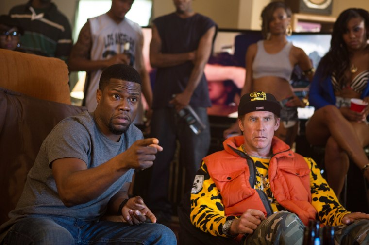 """In this image released by Warner Bros. Entertainment Inc., Kevin Hart, left, and Will Ferrell appear in a scene from the film, \""""Get Hard.\"""" (Photo by Patti Perret/Warner Bros. Entertainment Inc. via AP)"""