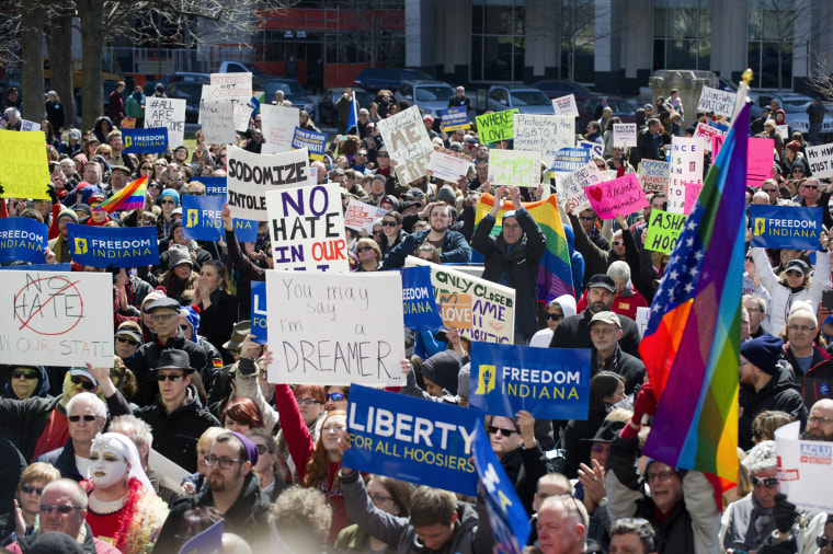 Thousands of opponents of Indiana Senate Bill 101, the Religious Freedom Restoration Act, gathered on the lawn of the Indiana State House to rally against that legislation, March 28, 2015. (Photo by Doug McSchooler/AP)