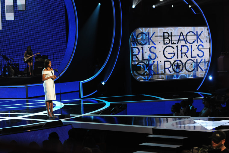 US First Lady Michelle Obama speaks onstage during the 'Black Girls Rock!' BET Special at NJPAC – Prudential Hall on March 28, 2015 in Newark, NJ. (Photo by D Dipasupil/BET/Getty)