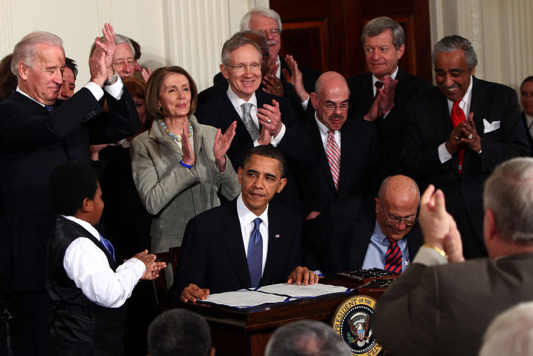 President Barack Obama is applauded after signing the Affordable Health Care for America Act during a ceremony with fellow Democrats in the East Room of the White House March 23, 2010 in Washington, DC. (Photo by Win McNamee/Getty)