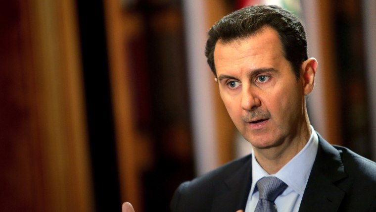 In a picture released on January 20, 2014, Syrian President Bashar al-Assad speaks during an interview with AFP at the presidential palace in Damascus. (Photo by Joseph Eid/AFP/Getty)