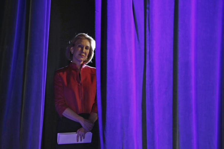 Former Hewlett-Packard Co Chief Executive Officer Carly Fiorina listens to her introduction from the side of the stage at the Freedom Summit in Des Moines, Ia., Jan. 24, 2015. (Photo by Jim Young/Reuters)