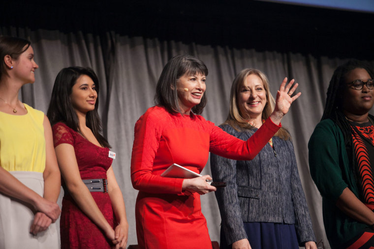 Gloria Feldt (center) onstage at the Take The Lead Challenge Launch in 2014.
